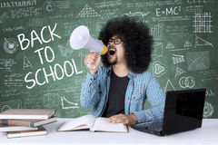 Afro college student with megaphone and scribbles Stock Photo