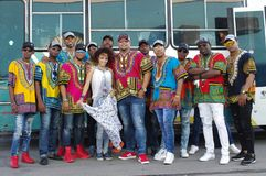 Afro Cuban Dance Ensemble. From Camagüey in central Cuba wearing Caribbean style costumes posing in front of a bus Stock Image