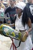 Afro-Cuban female drummer. Plays Cuban rumba beats at Callejón de Hamel on Sunday afternoon in Centro Havana in Cuba stock photography