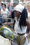 Afro-Cuban female drummer. Plays Cuban rumba beats at Callejón de Hamel on Sunday afternoon in Centro Havana in Cuba royalty free stock photos