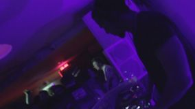 Afro DJ set in nightclub, wide and close-up, turntable buttons, dancing people. Stock footage stock video