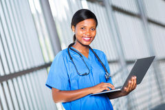 Afro doctor laptop Stock Photo