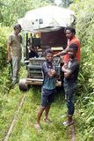 Local people in front of a homemade `ghost train` that run on abandoned railroad tracks. Afro-Ecuadorian men and boys in front of a homemade `ghost train` Stock Photos