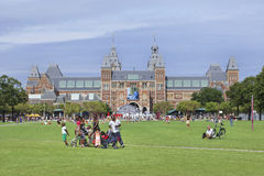 Afro family at Museum Square, Amsterdam, netherlands. Royalty Free Stock Photos