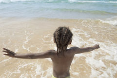 Afro girl at the beach, six years old. Afro girl at the beach,  six years old Royalty Free Stock Photos