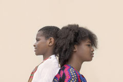 Afro girl and boy positioned back-to-back Royalty Free Stock Photo