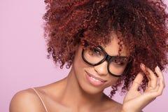 Afro girl in eyeglasses, smiling. royalty free stock photo