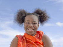 Afro girl with pigtails laughing, ten years old Royalty Free Stock Photo