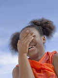 Afro girl with pigtails laughing, ten years old Royalty Free Stock Images