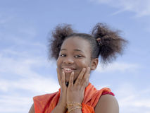 Afro girl with pigtails smiling, ten years old Stock Photography