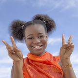Afro girl with pigtails smiling, ten years old Royalty Free Stock Photos