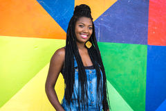 Afro girl smiling on colorful background Stock Photo