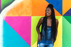 Afro girl smiling on colorful background Stock Image