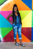 Afro girl smiling on colorful background Royalty Free Stock Photos