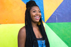 Afro girl smiling on colorful background Stock Images