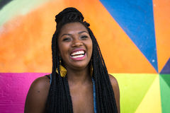 Afro girl smiling on colorful background Stock Photos