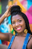 Afro girl smiling on colorful background Royalty Free Stock Photography