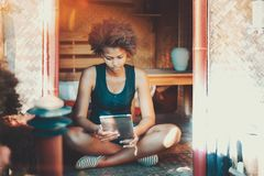 Afro girl on summer veranda with tablet pc royalty free stock images