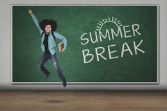 Afro guy leaping with summer break word Stock Image