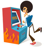 Afro guy plays arcade game Stock Photos