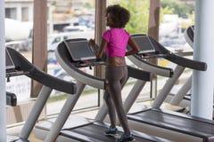 Afro kobiety amerykański bieg na karuzeli Obrazy Stock
