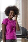 Afro kobiety amerykański bieg na karuzeli Fotografia Royalty Free