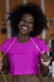 Afro kobiety amerykański bieg na karuzeli Zdjęcie Stock