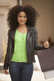Afro latin woman smiling with shopping bags Royalty Free Stock Photo