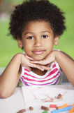 Afro little girl drawing Stock Photos
