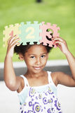 Afro little girl having fun with numbers Stock Photography
