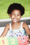 Afro little girl having fun with numbers Stock Image