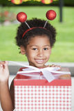 Afro little girl with present Royalty Free Stock Photo