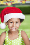 Afro little girl with santa hat Royalty Free Stock Image
