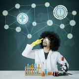 Afro male scientist thinking an idea Stock Image