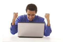 Afro man angrily shouting at his laptop. Afro Man shouting at laptop , angry facial expression royalty free stock photo