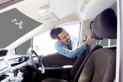 Free Afro Man Checking His Car Seat On Studio Stock Images - 108784434