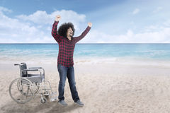 Afro man gets up from wheelchair Stock Images
