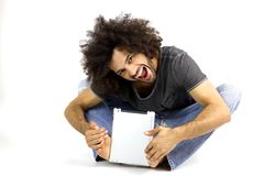 Afro man having fun with tablet in studio Royalty Free Stock Photo