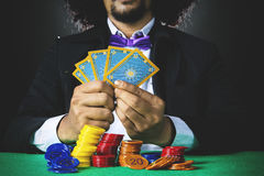 Afro man holds poker cards Stock Image