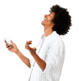 Afro man laughing with his cell Stock Images