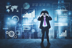 Afro man looking at financial chart with binocular. Portrait of Afro man using a binocular while looking at the financial chart in the virtual screen Stock Image