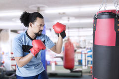 Afro man practice boxing at gym Stock Image