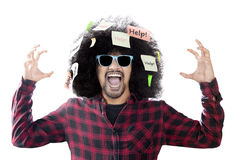 Afro man screaming with help word Stock Photography