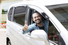 Afro man showing thumbs up in his car Stock Photos