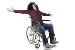 Afro man sitting on a wheelchair Royalty Free Stock Images