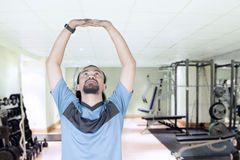 Afro man stretching hands at gym Stock Images