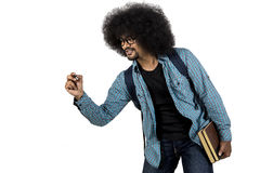 Afro man writing on copy space with book Royalty Free Stock Photos