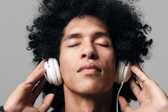 Afro music headphones Stock Photography