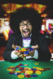 Afro person winning a gambling in casino Royalty Free Stock Images