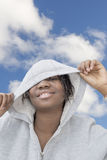 Afro preteen playing with her hooded sweatshirt Stock Images
